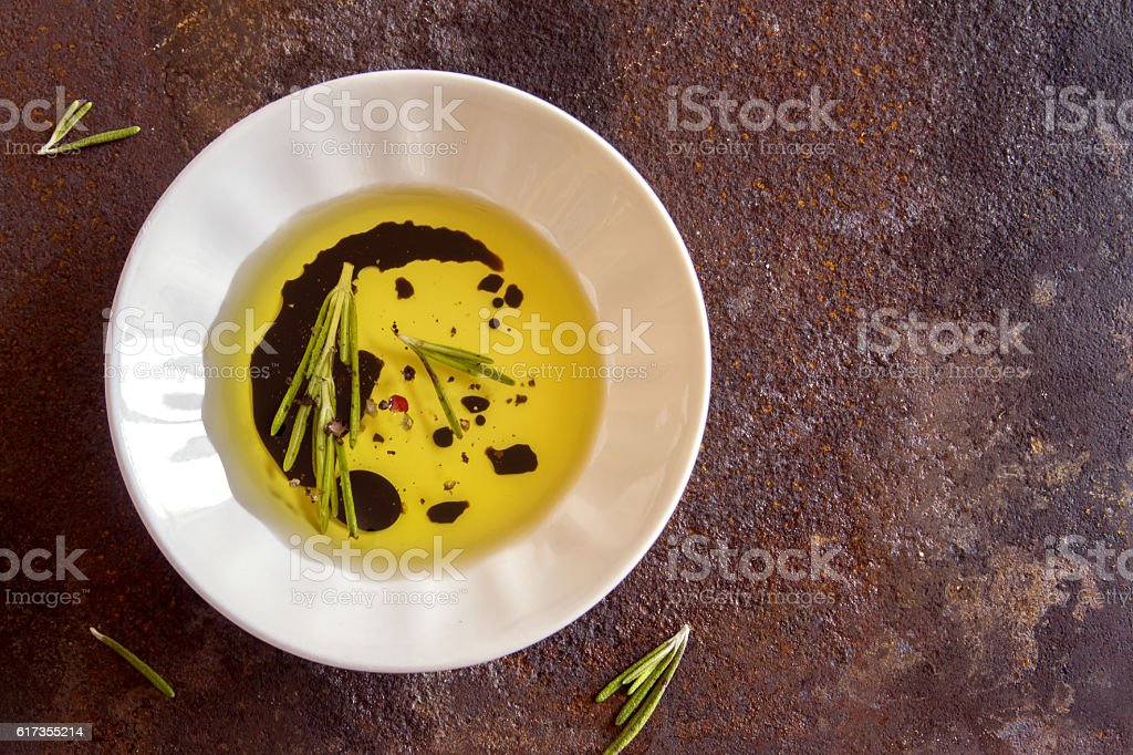 olive oil with spices stock photo