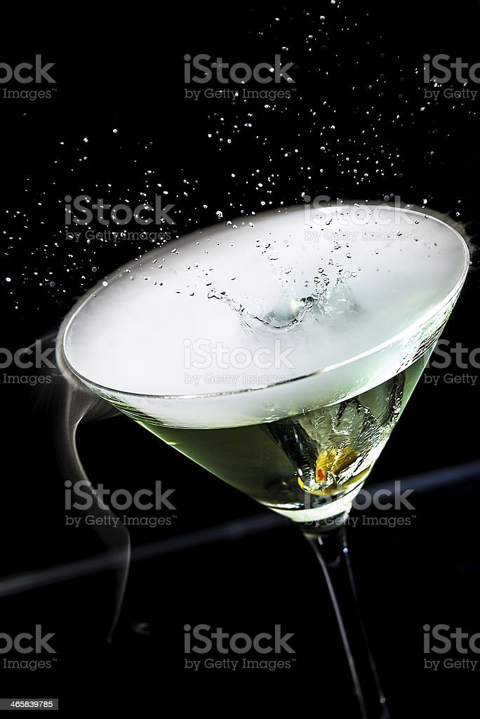 Olive splashing in a martini cocktail royalty-free stock photo