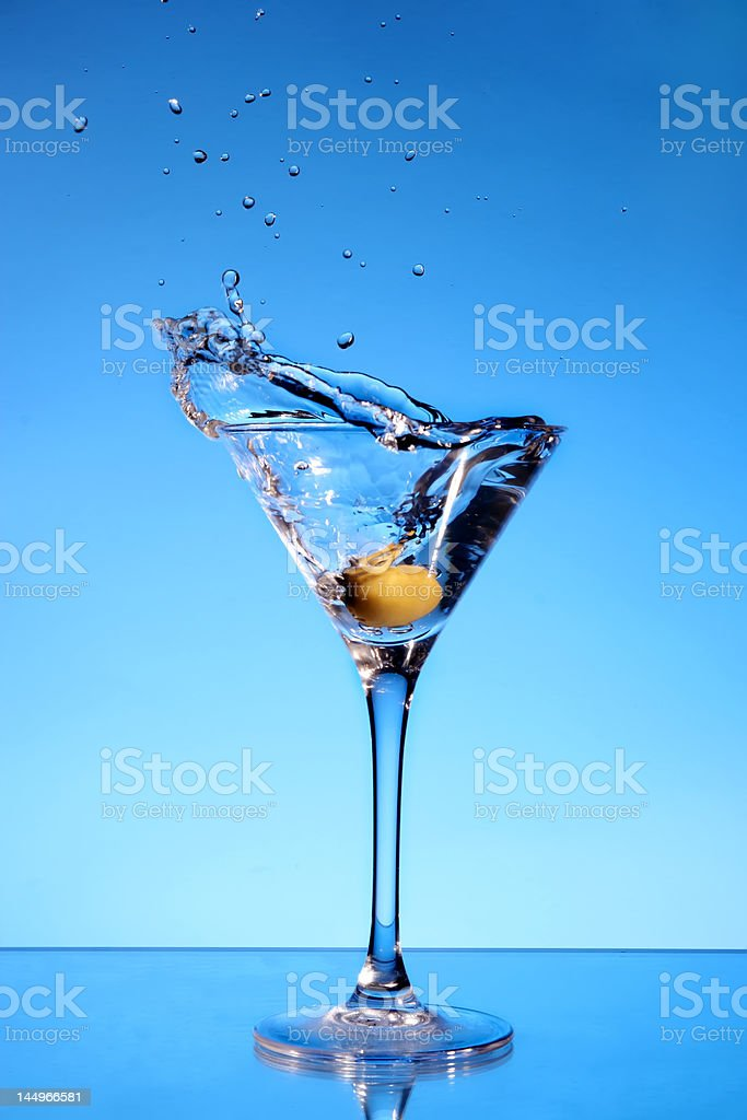 Olive splashing in a Martini glass royalty-free stock photo
