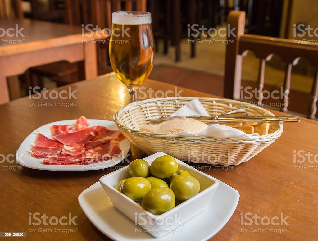olives and ham tapas stock photo