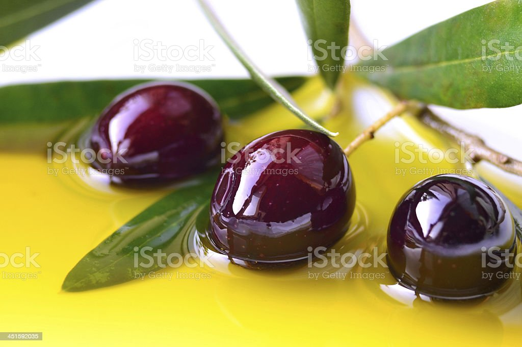 Olives and olive oil closeup stock photo