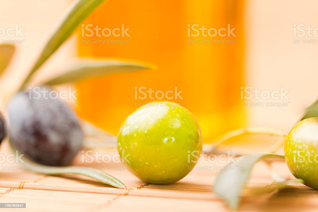 Olives and olive oil in bottle stock photo