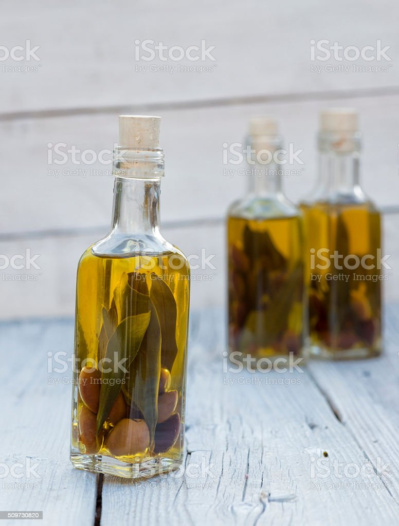 olives and olive oil in mini bottle on wood table stock photo