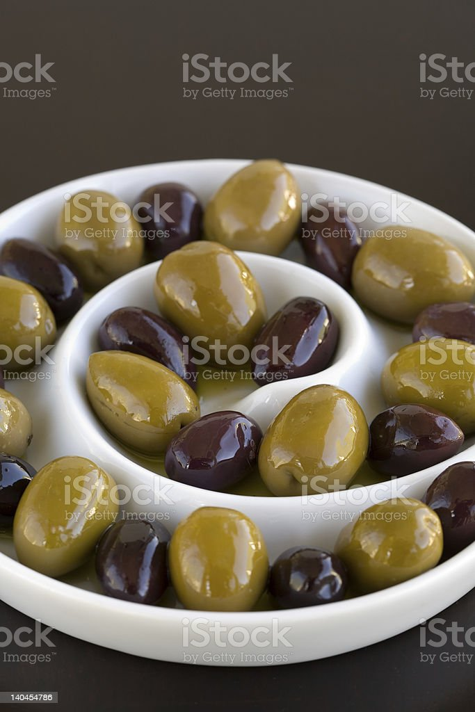 Olives in spiral dish stock photo