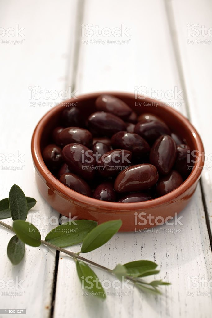 olives on a table with branch stock photo