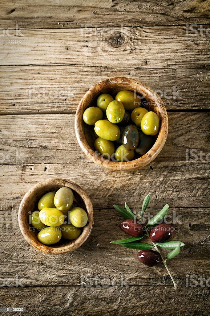 Olives on wood stock photo