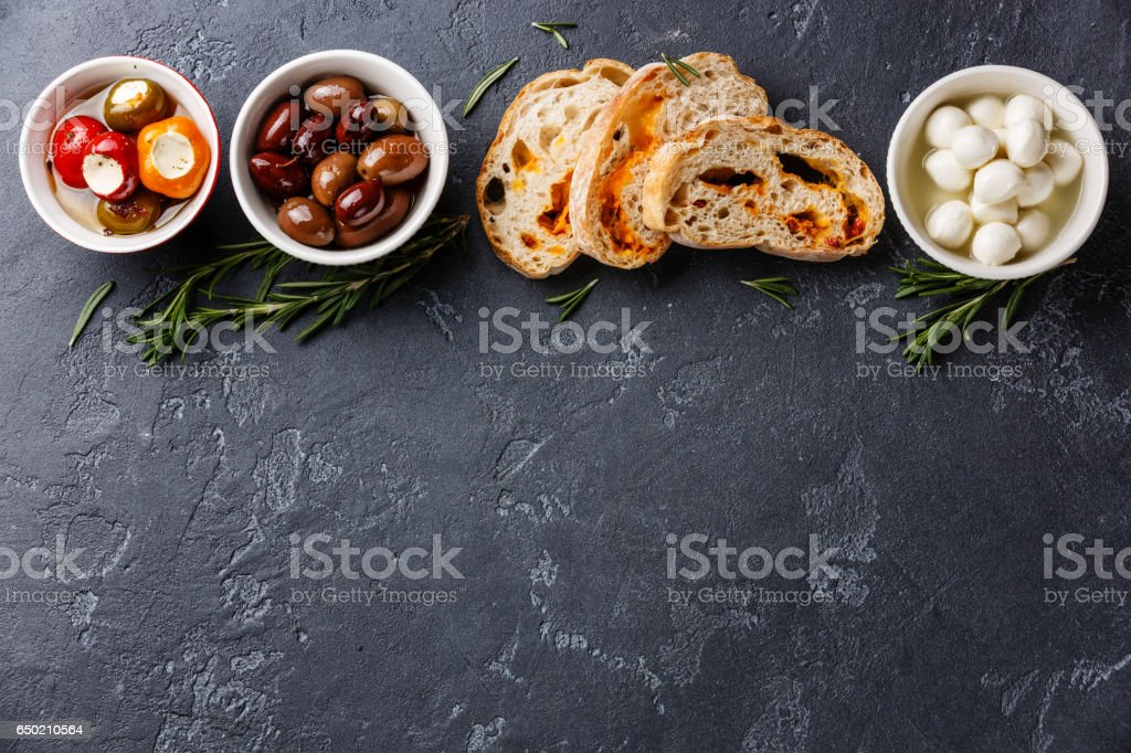 Olives, Peppers, Mozzarella and Ciabatta stock photo