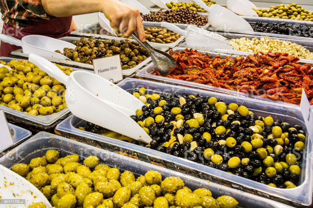 Olives, sun dried tomatoes and almonds on market stock photo