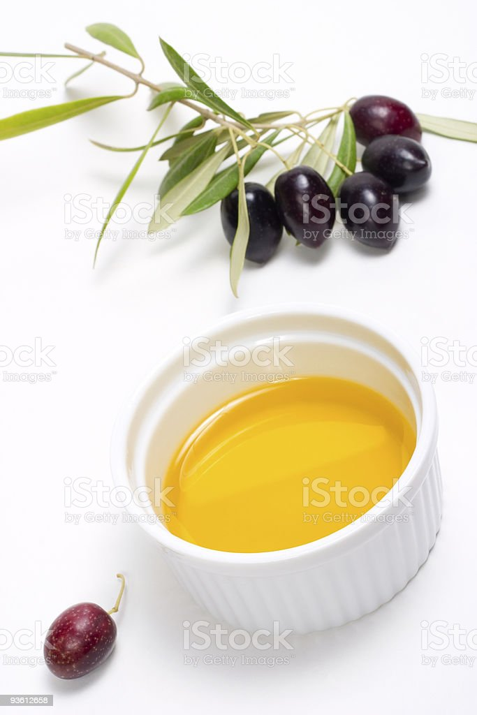 Olives twig and pure olive oil royalty-free stock photo