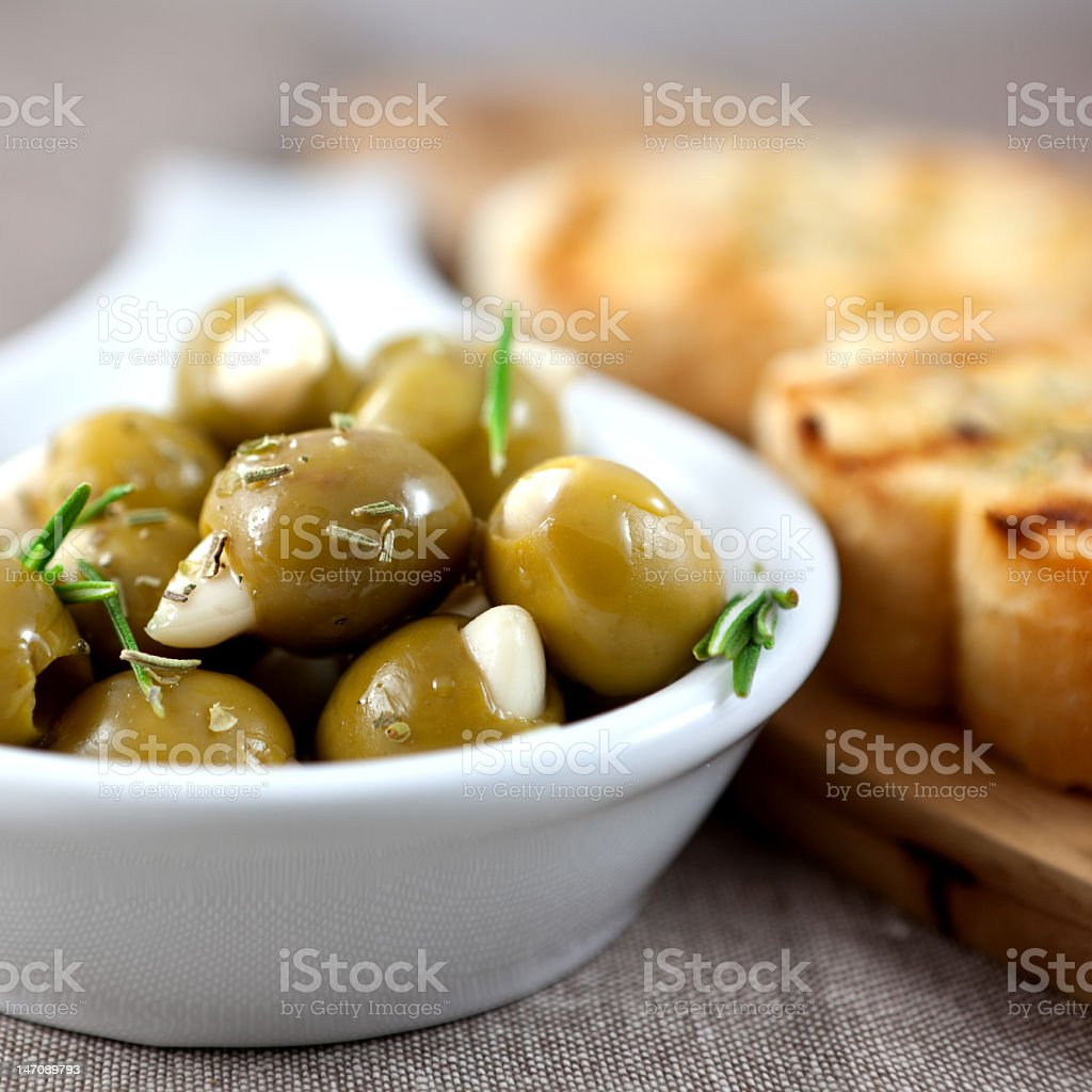 Olives with garlic and herbs royalty-free stock photo