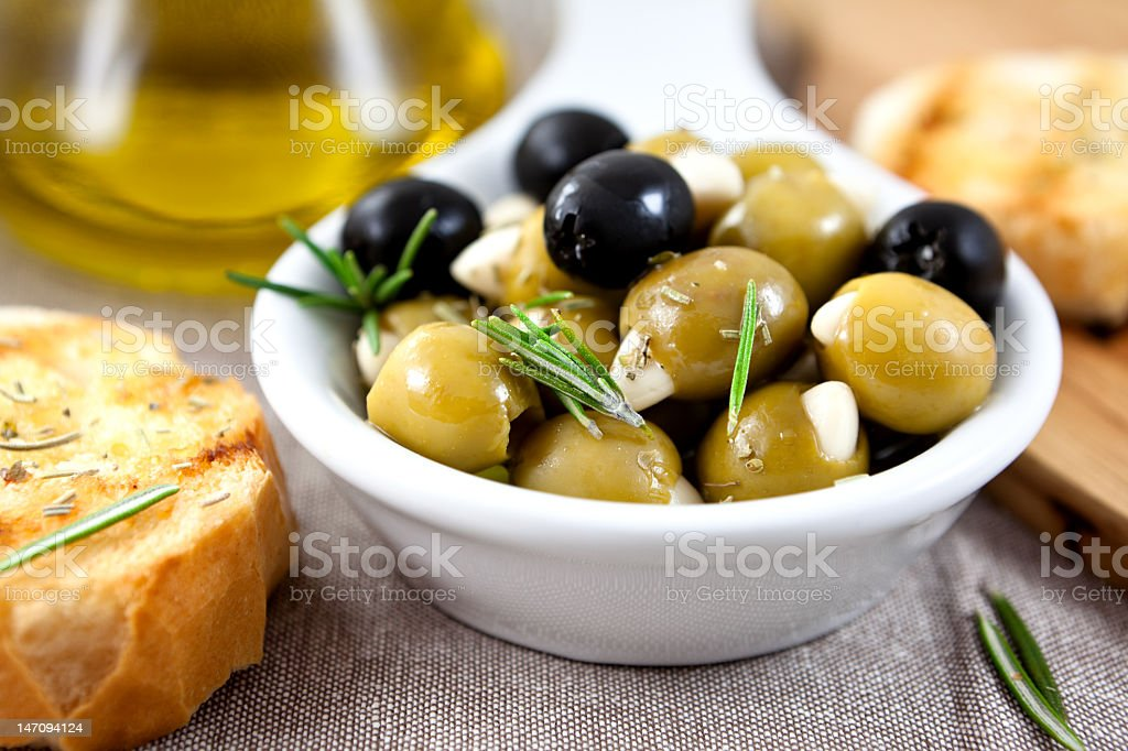 Olives with garlic and herbs stock photo