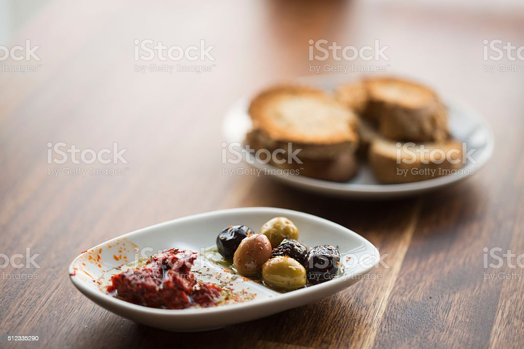 Olives with tomato paste and bread stock photo