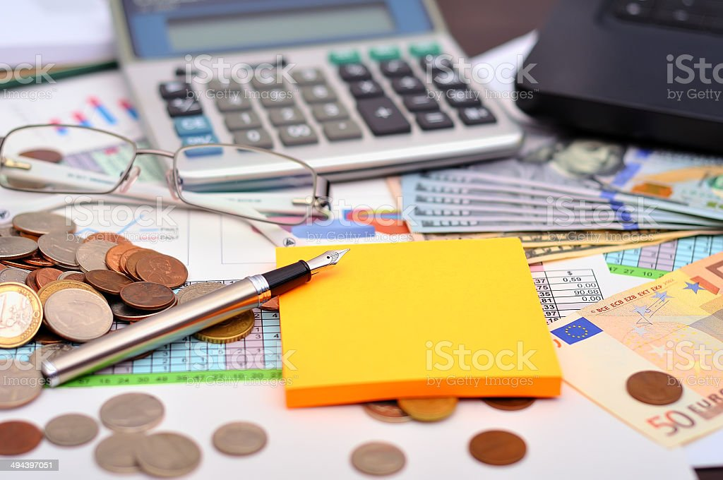 ollars and office calculator stock photo
