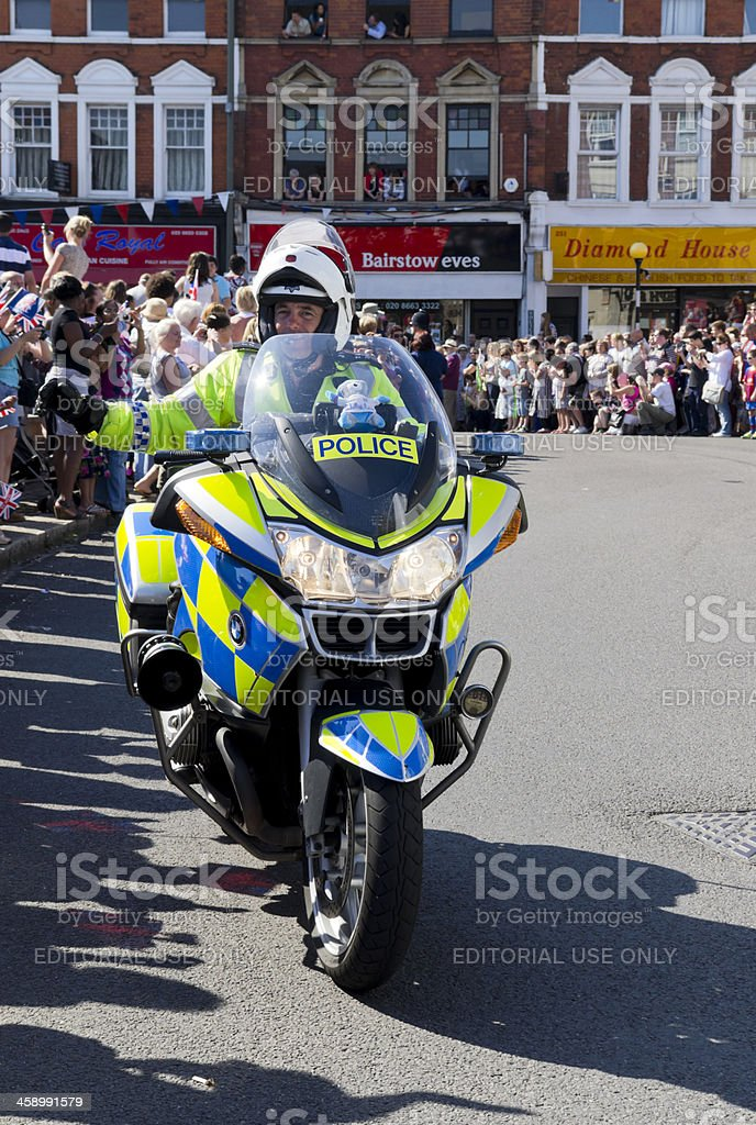 Olympic Torch Relay - police high-fives stock photo