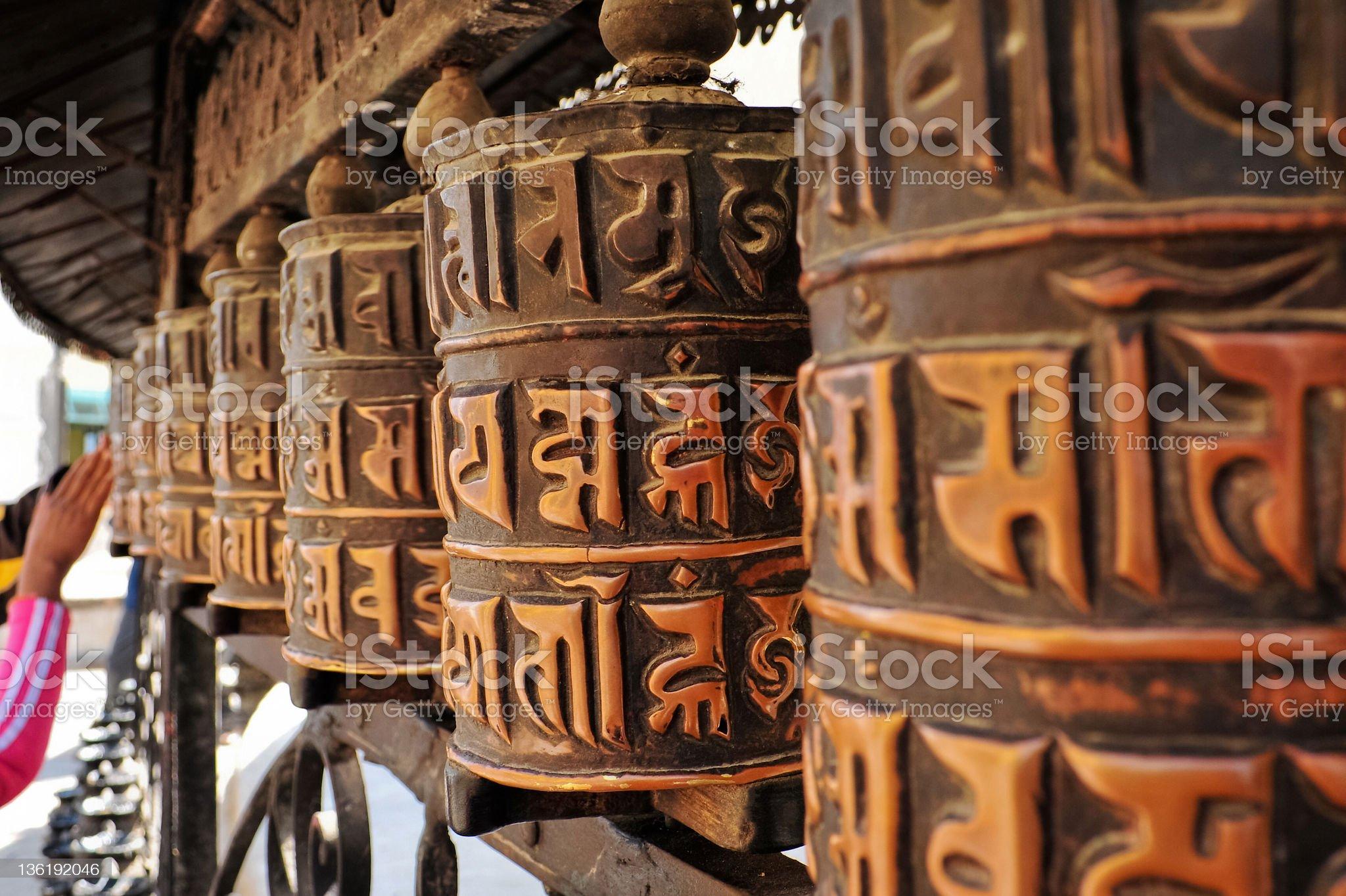 Om Mani Padme Hum praying wheels royalty-free stock photo
