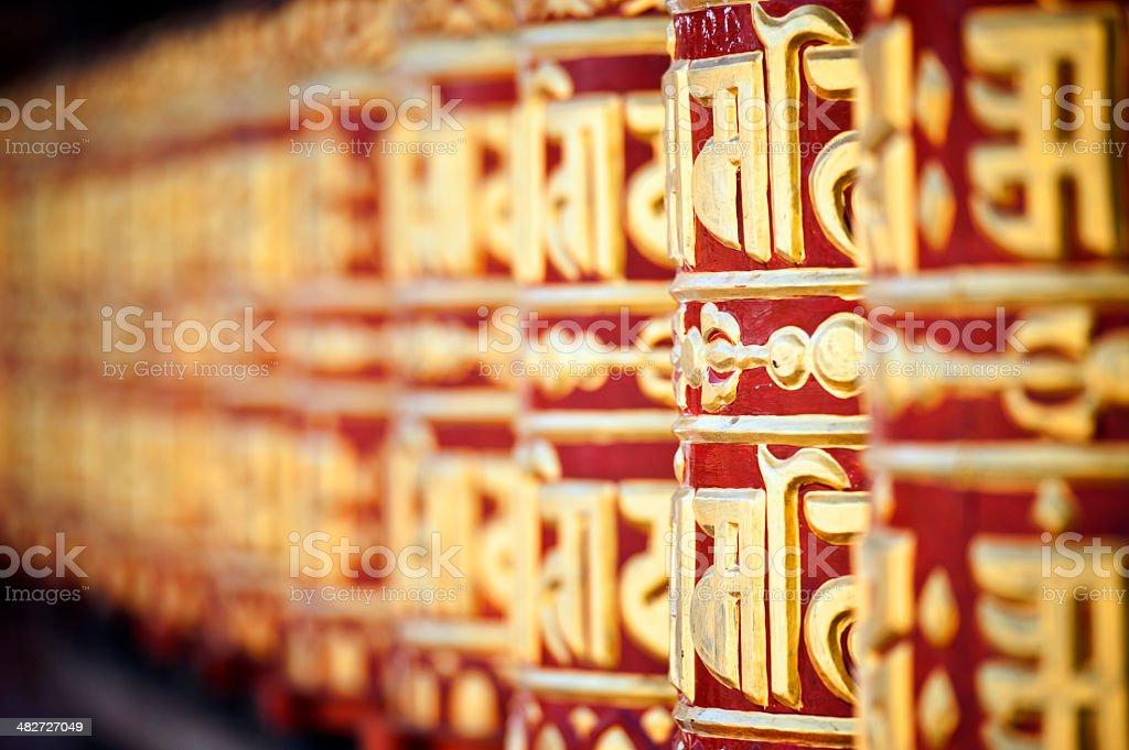 Om Mani Padme Hum praying wheels stock photo