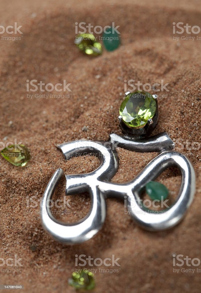Om sign on a desert sand background royalty-free stock photo