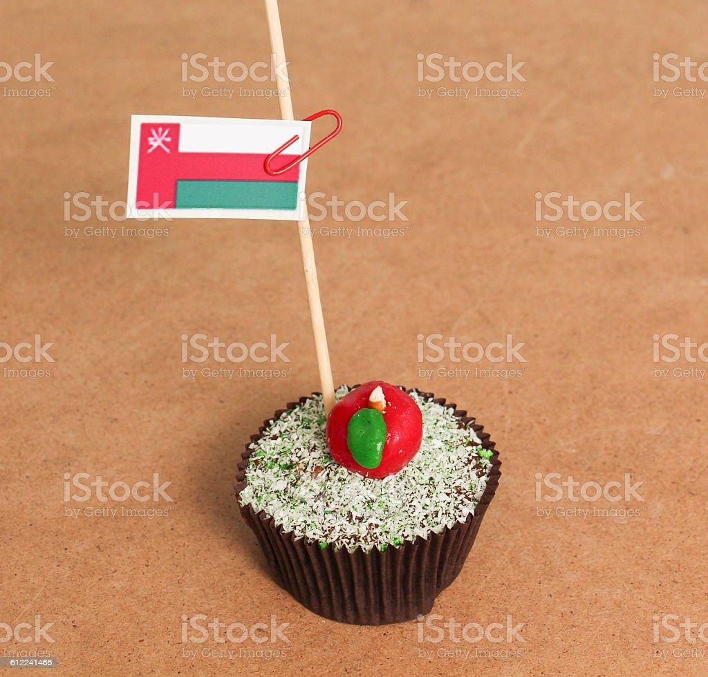 oman flag on a apple cupcake stock photo