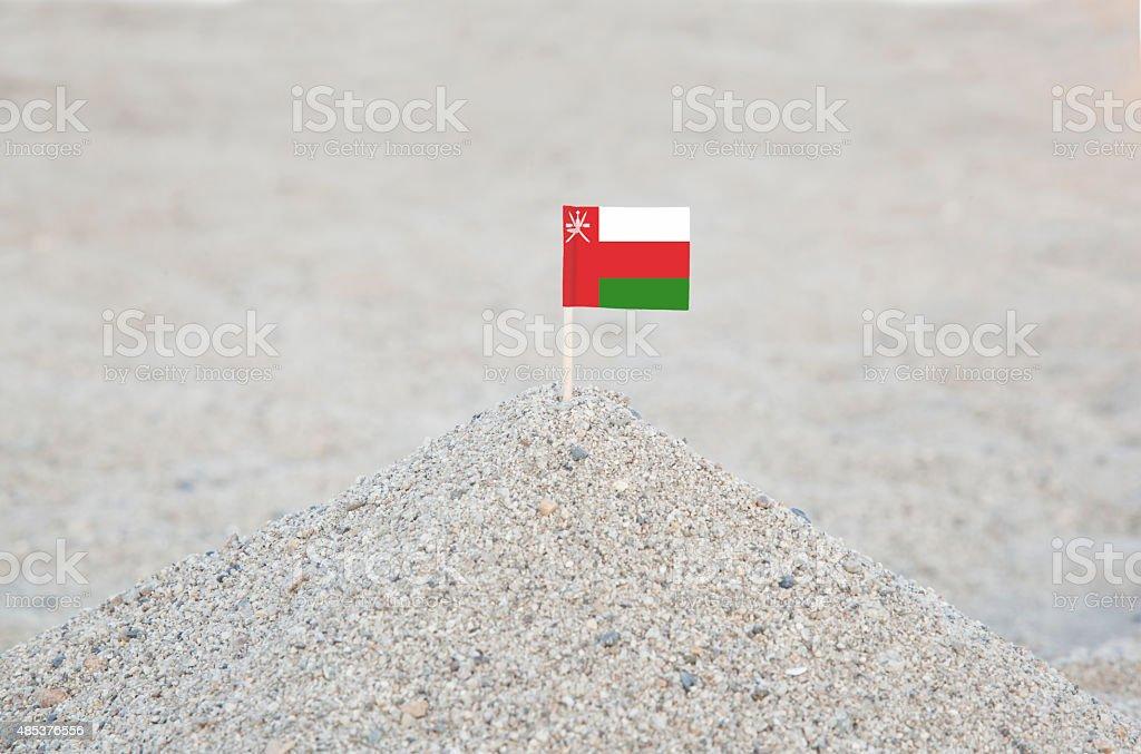 Oman Flag on the Beach stock photo