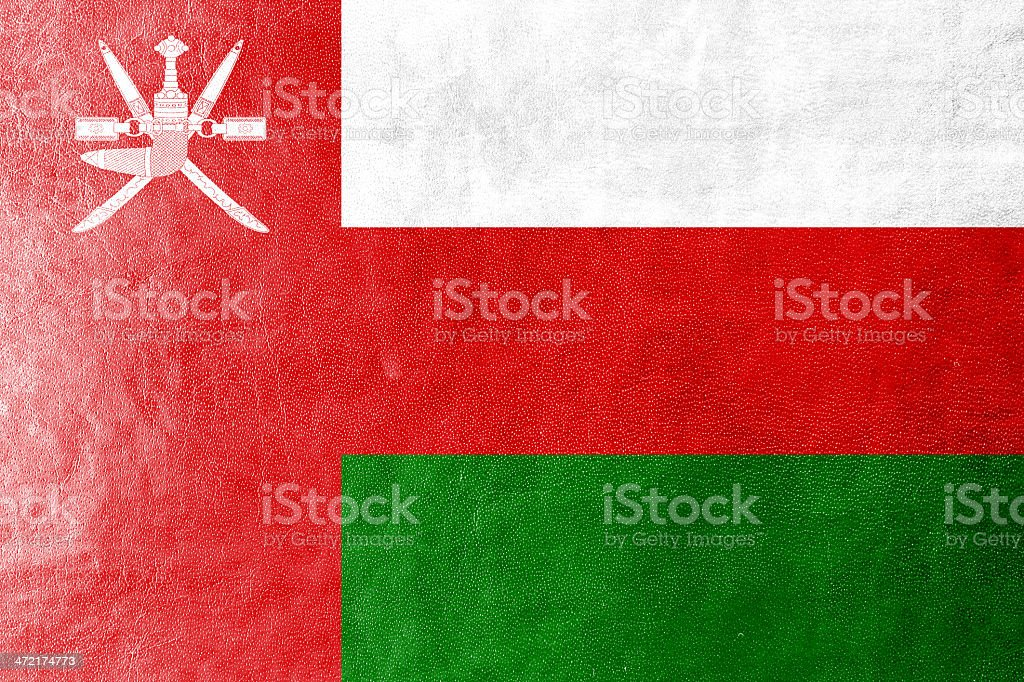 Oman Flag painted on leather texture stock photo