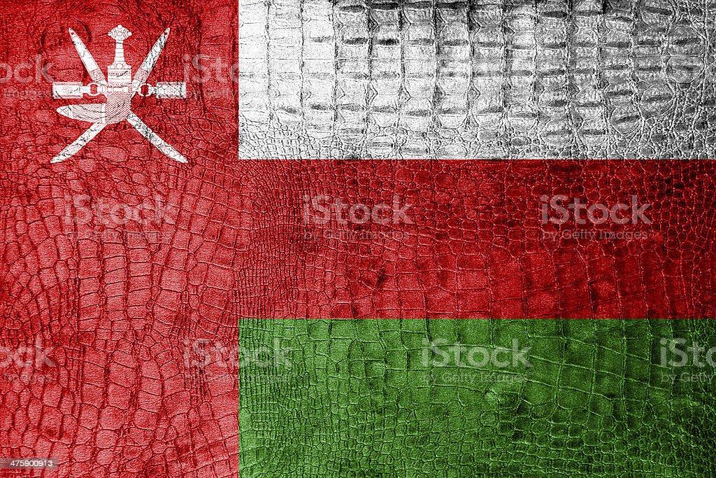 Oman Flag painted on luxury crocodile texture stock photo