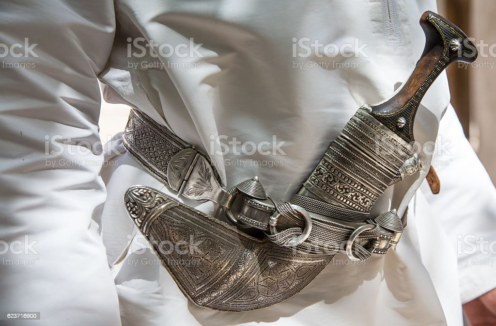 omani dagger or 'khanjah' worn on a belt of traditional omani stock photo