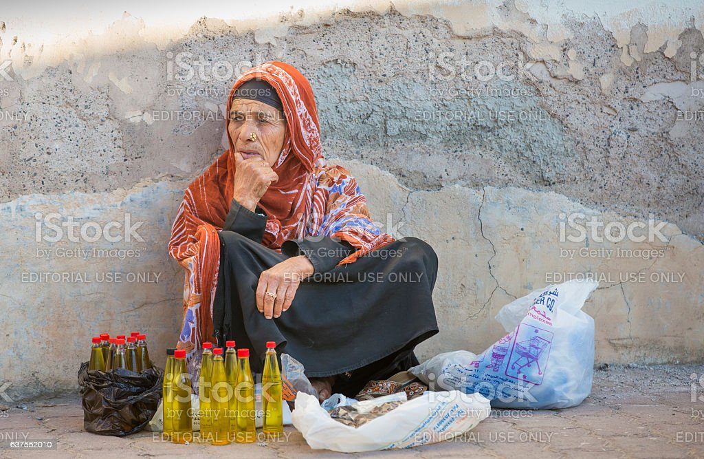 omani lady selling oil at the Nizwa market stock photo