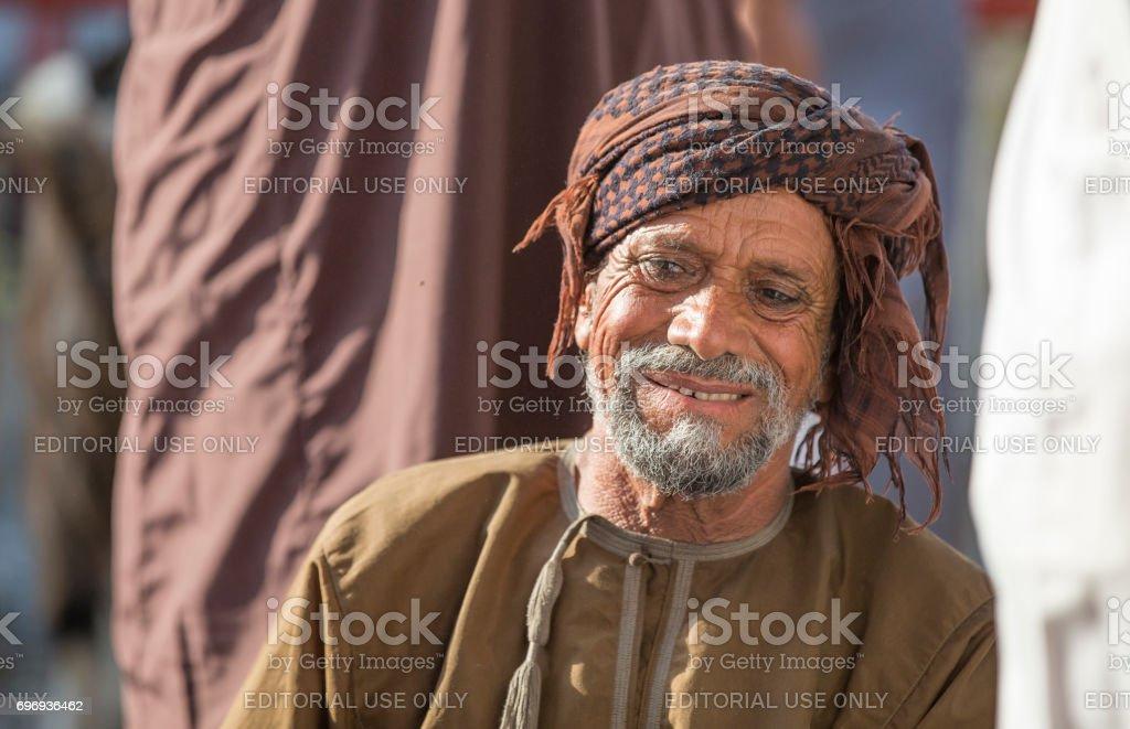 Omani man in Nizwa goat market stock photo