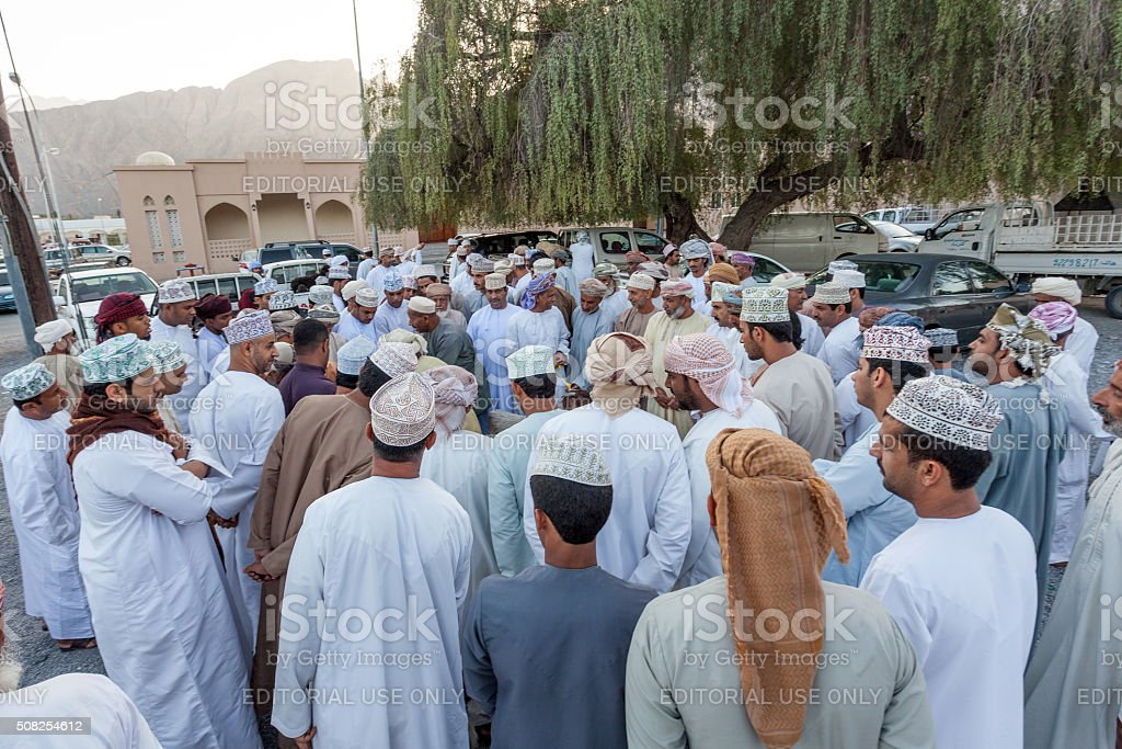 Omani men at the market in Nakhl, Oman stock photo
