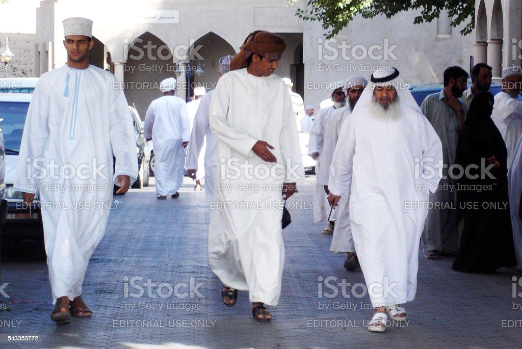 Omani men wearing traditional Dishdasha clothing stock photo