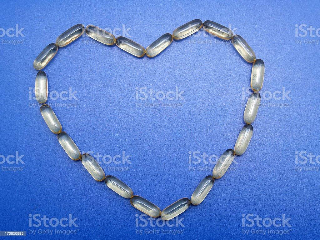 Omega 3 capsules heart shape royalty-free stock photo