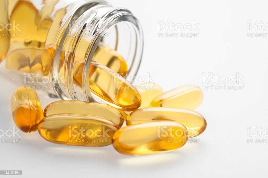 Omega 3 fish oil capsules and bottle stock photo