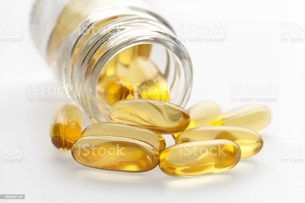 Omega 3 fish oil capsules and bottle royalty-free stock photo