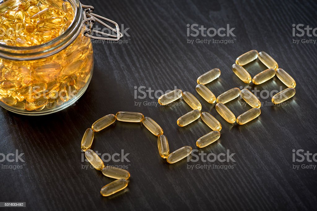 Omega 3-6-9 fish oil yellow softgels drawing omega 3-6-9  letters stock photo