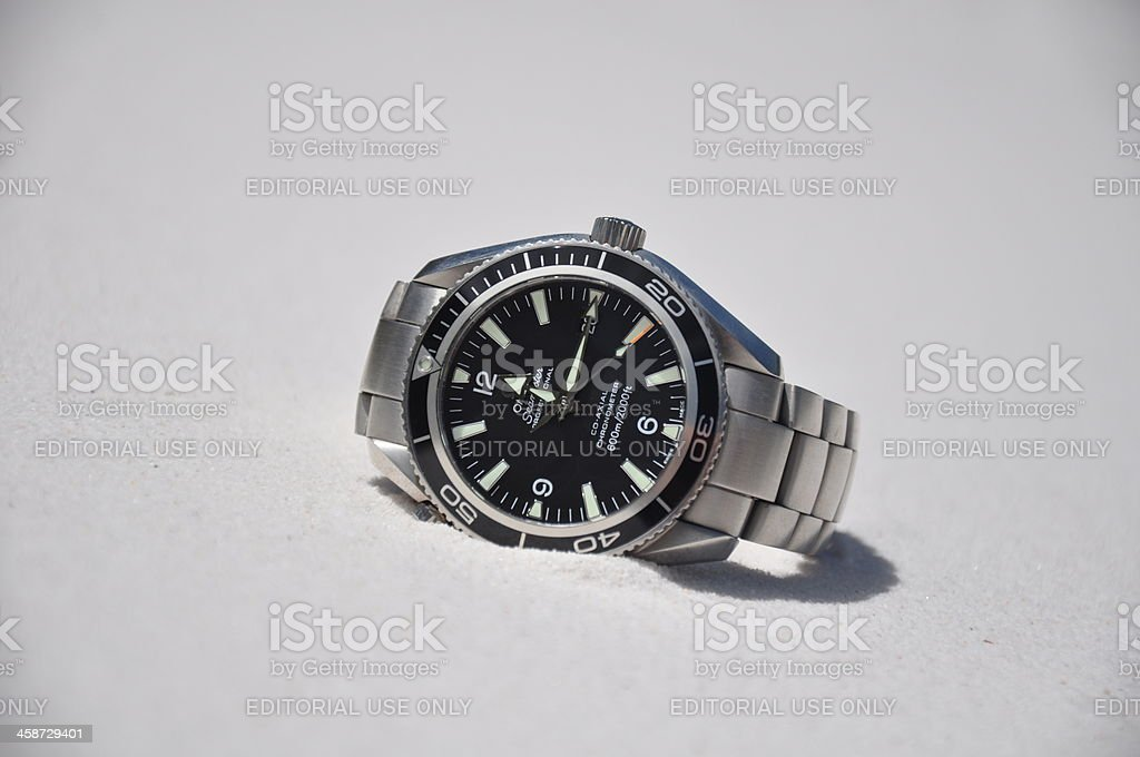 Omega watch on sand stock photo