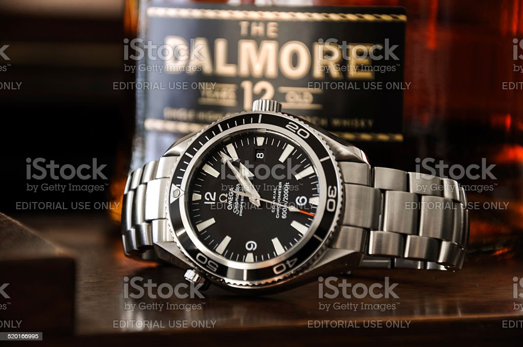 Omega watch with Dalmore Scotch Whisky stock photo