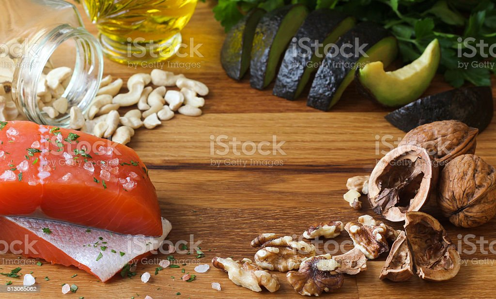 Omega-3 salmon avocado on wood stock photo