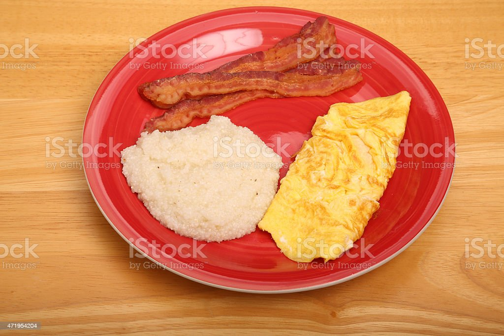 Omelet Grits and Bacon stock photo