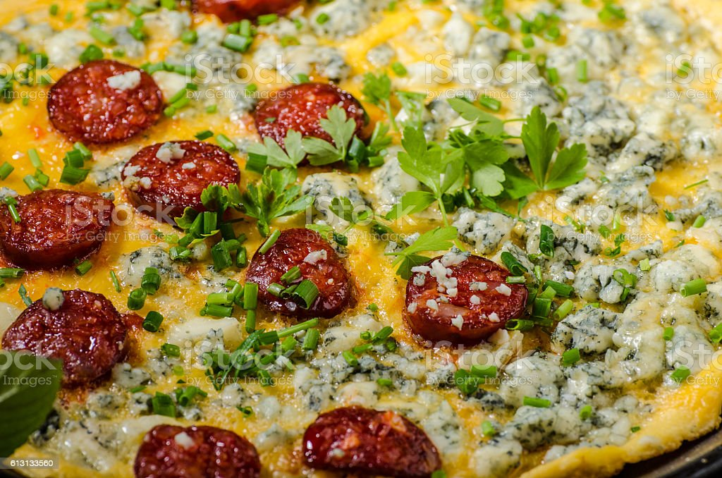 Omelet with blue cheese and sausage stock photo