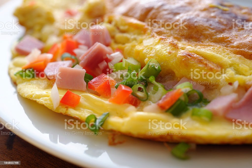 Omelet with ham and peppers inside royalty-free stock photo
