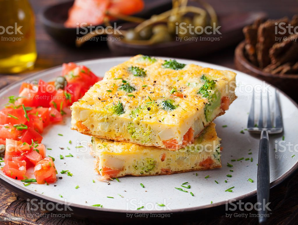 Omelet with smoked salmon and broccoli on a plate stock photo