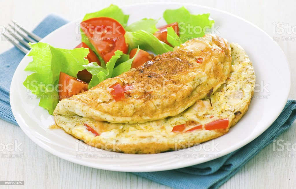 Omelet with vegetable salad royalty-free stock photo