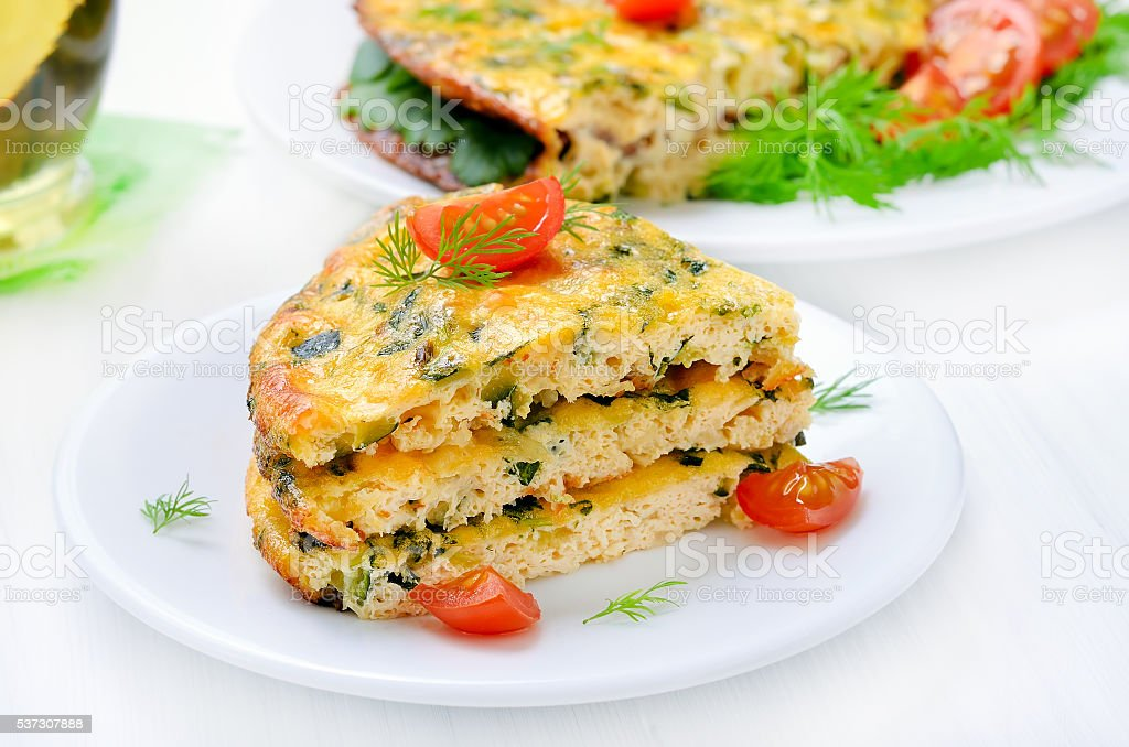 Omelet with vegetables on the plate stock photo