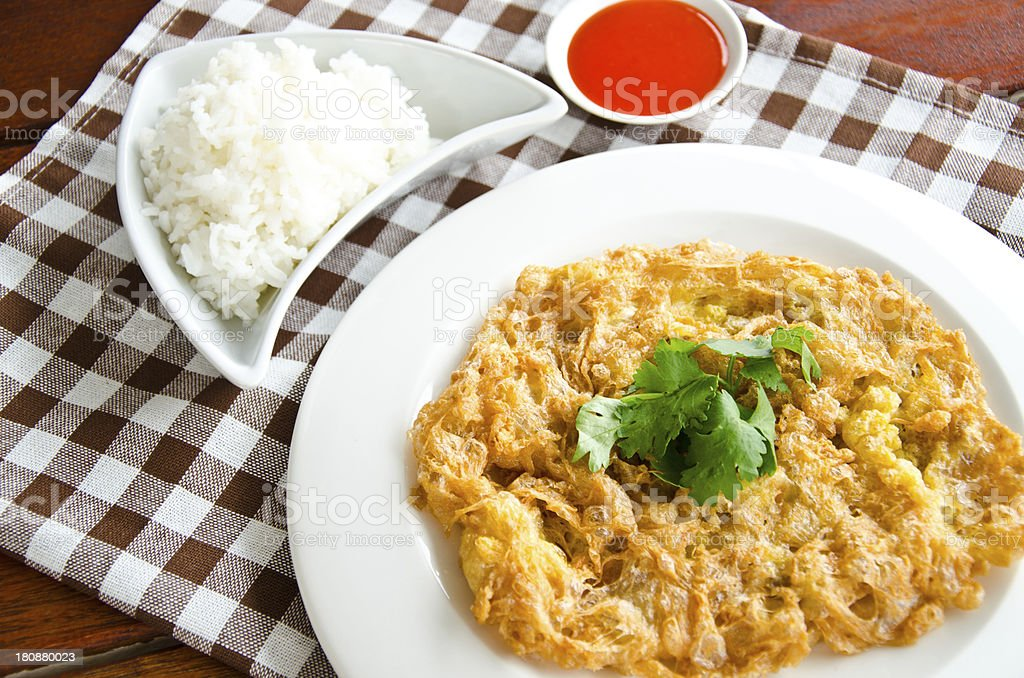 Omelette served with steamed rice royalty-free stock photo