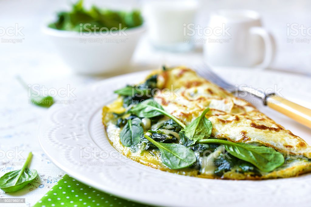 Omelette stuffed with spinach and cheese. stock photo