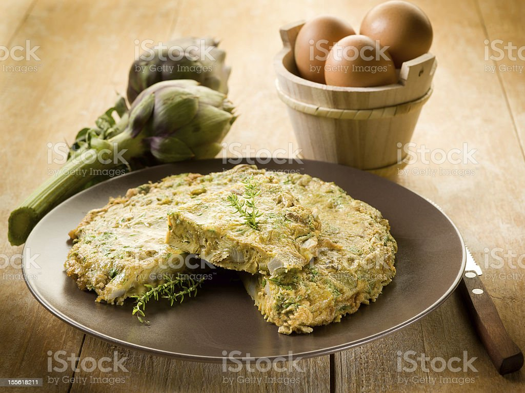 omelette with artichokes stock photo