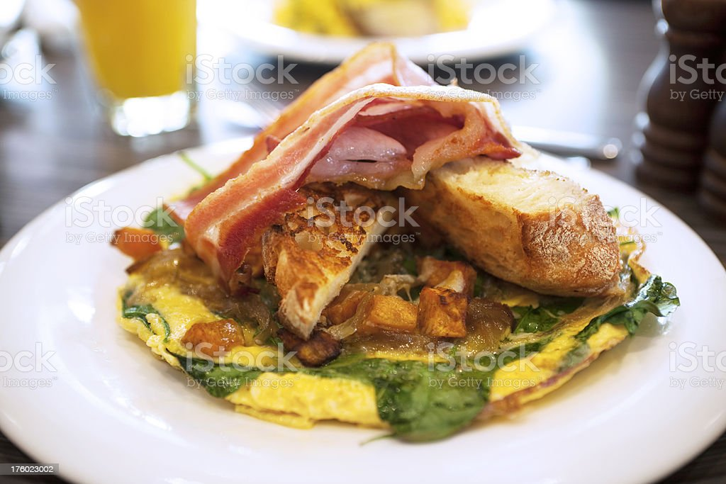 Omelette with bacon and toast royalty-free stock photo
