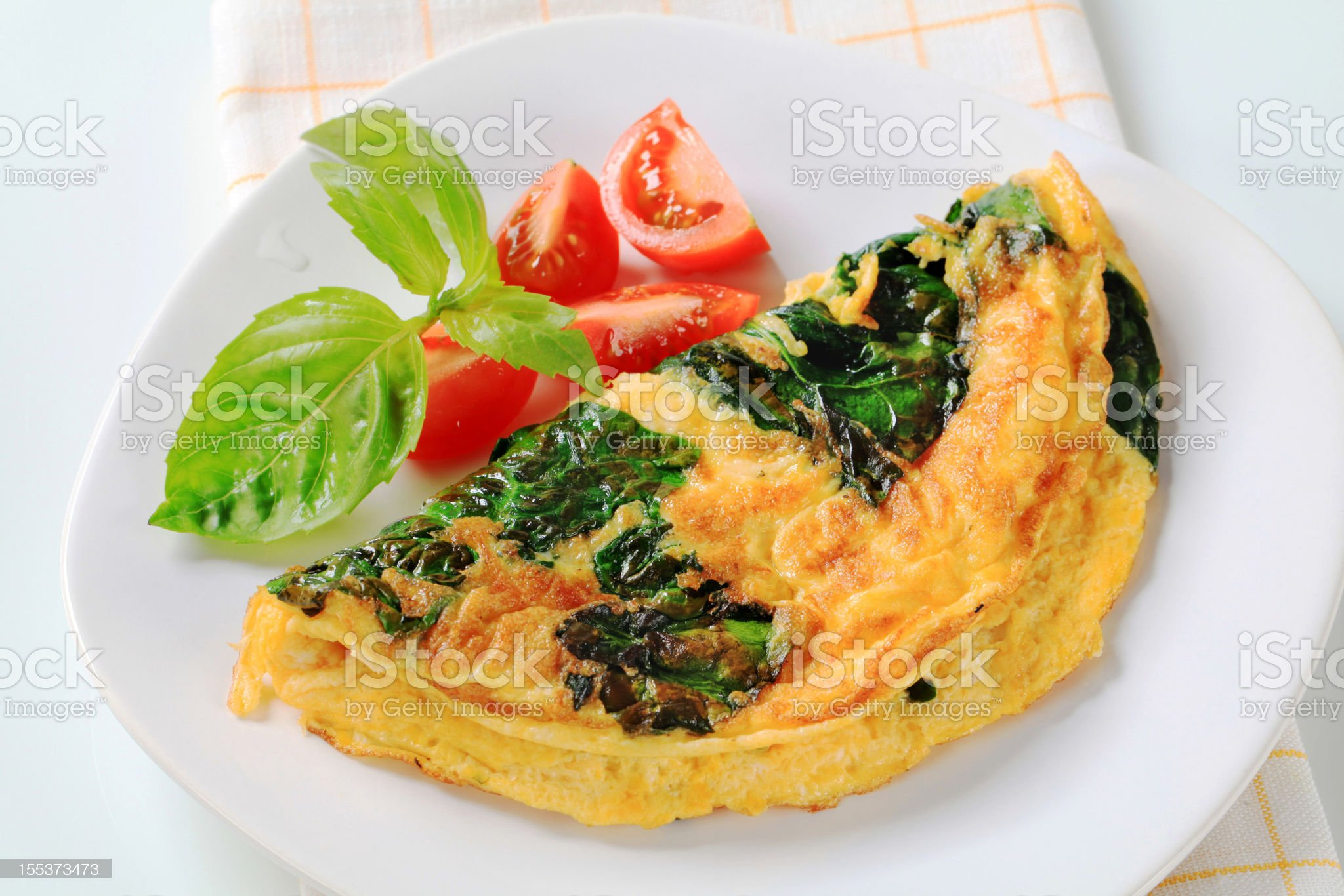 Omelette with cheese and spinach royalty-free stock photo