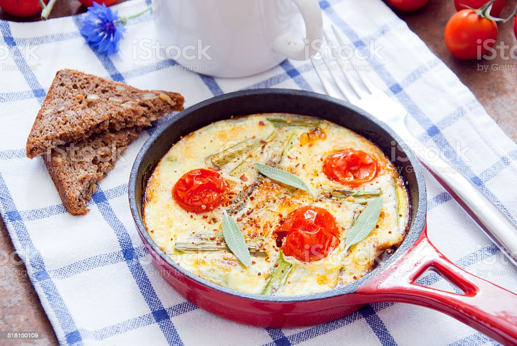 Omelette with cherry tomatoes stock photo