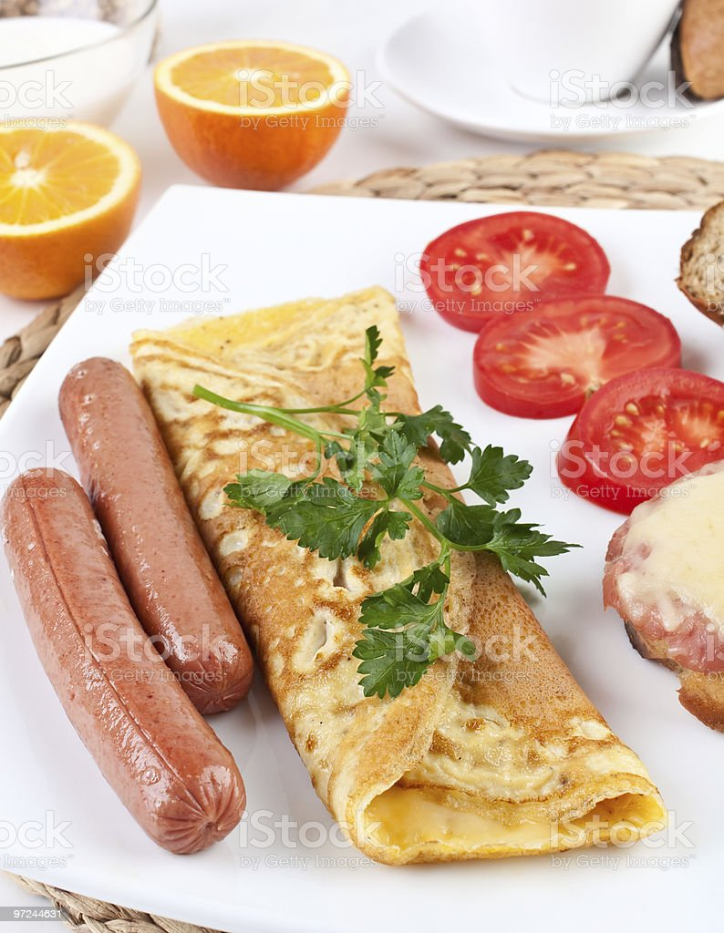 omelette with sausage and vegetables close up stock photo